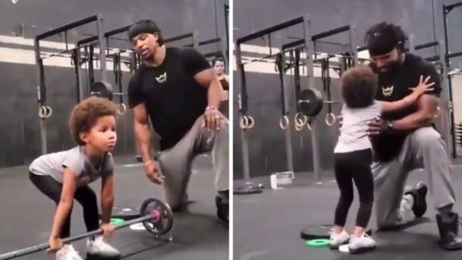 Padre anima a su hija en el gimnasio